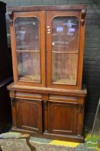 Victorian Mahogany Bookcase with Two Glass Panel Doors above Two Drawers and Arch Panel Doors.