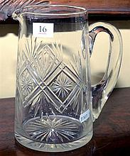 A TALL EDWARDIAN HAND CUT CRYSTAL WATER JUG