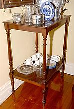 AN ANTIQUE COLONIAL CEDAR 2 TIER SERVERY RAISED ON RING & TAPERED TURNINGS.