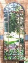 A steel framed arch garden mirror with 14 panels, height 208, width 80cm