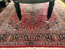 A large Persian Kashan carpet, 365 x 255cm