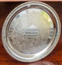 A Hecworth silverplate circular tray. D: 30cm