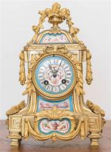 A French 19th Century porcelain and ormolu mantel clock, decorated with cherubs and vases of pomegranates, by Henry Marc, height 31cm