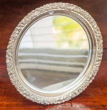 A Hecworth silverplate on copper circular tray. D: 28cm.