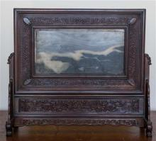 A Chinese carved stone table screen with hard wood stand L42cm, H37cm