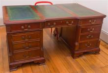 A 3 panelled leather top mahogany double pedestal 12 drawer Partnership desk, each drawer fitted with brass drop handles. C: Mid to...