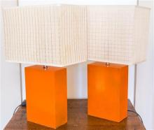 A pair of modernistic table lamps in burnt orange, with cream square shades, height
