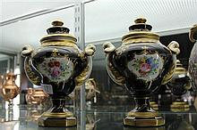 Pair of French Porcelain Blue and Gilt Lidded Urns with Hand Painted Floral Cartouches