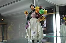 Royal Doulton Figure 'Biddy Penny-farthing' HN 1843 restored