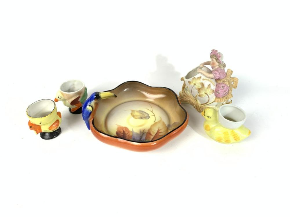 A Ceramic Bird Themed Bowl Together with 3 Egg Cups and A Ceramic Figure of A Lady