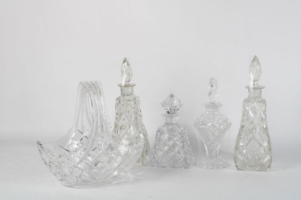 Collection of Crystal Cut Glass Bottles with Stoppers Together with A Basket