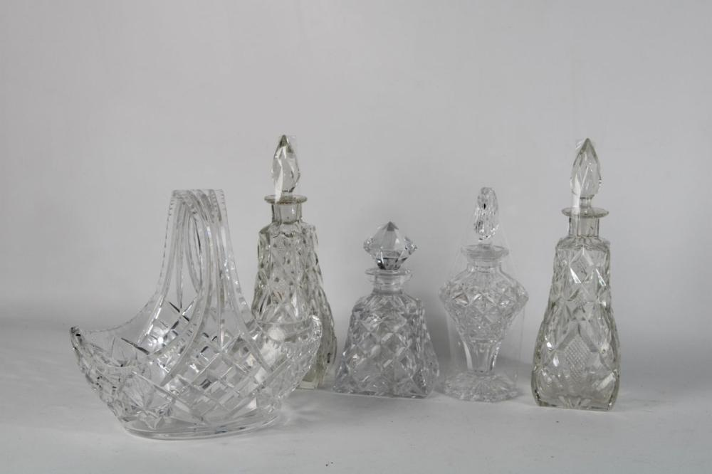 Lot 122: Collection of Crystal Cut Glass Bottles with Stoppers Together with A Basket