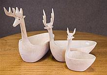 Three graduated timber Reindeers