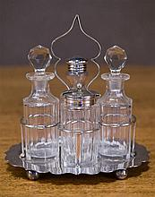 An Edwardian English silver plate and cut crystal 4 bottle cruet stand. C. 1900