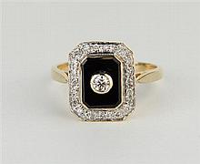 A Deco style and stone set ring the onyx tablet applied with round brilliant cut diamonds encircled with round brilliant cut diamonds i