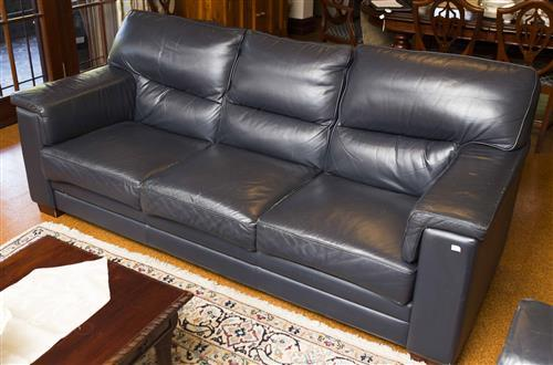 A Four Piece Moran Navy Leather Lounge Suite Exclusively Fo