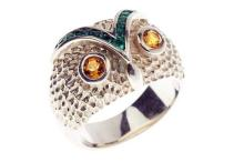 A STERLING SILVER OWL RING; design by Karen Walker set with pastes, size N-O with original box.