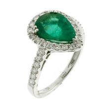 AN 18CT WHITE GOLD EMERALD AND DIAMOND RING; pear shape emerald estimated as 2.37 ct to surround and shoulders set with round brilli...