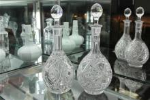Heavily Cut Crystal Decanter & Another Similar Example