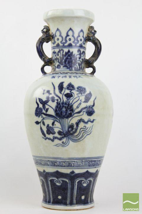 Chinese blue and white double handled vase, Xuande mark, body decorated with three lotus floral roundels