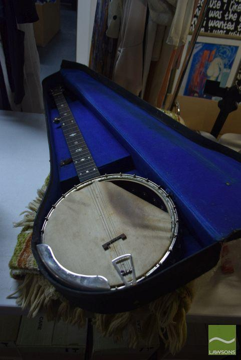 Cased Banjo with inlaid wood (AF) with handwoven lounge rug