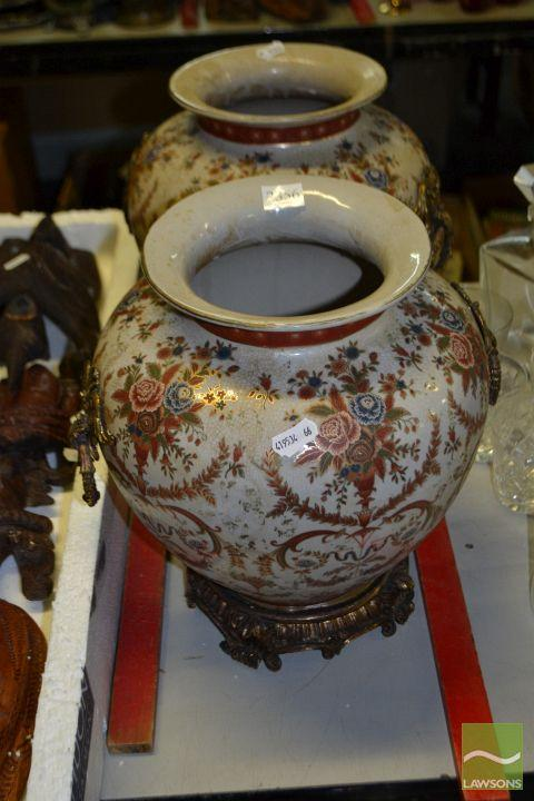 Pair of Floral Ceramic Urns with Brass Fittings