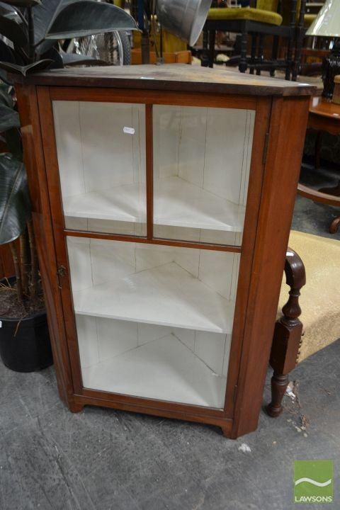 An early 20th Century corner cabinet with white painted interior