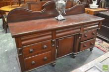 A Victorian Welsh Dresser, probably mahogany, with central door flanked by 7 drawers.