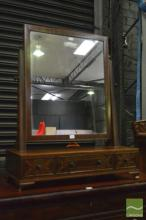 An Edwardian Inlaid Mahogany Toilet Mirror fitted with 3 drawers on bracket feet.