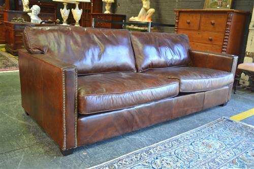 Three seater distressed deep brown leather sofa with chrome for Brown leather couch with studs