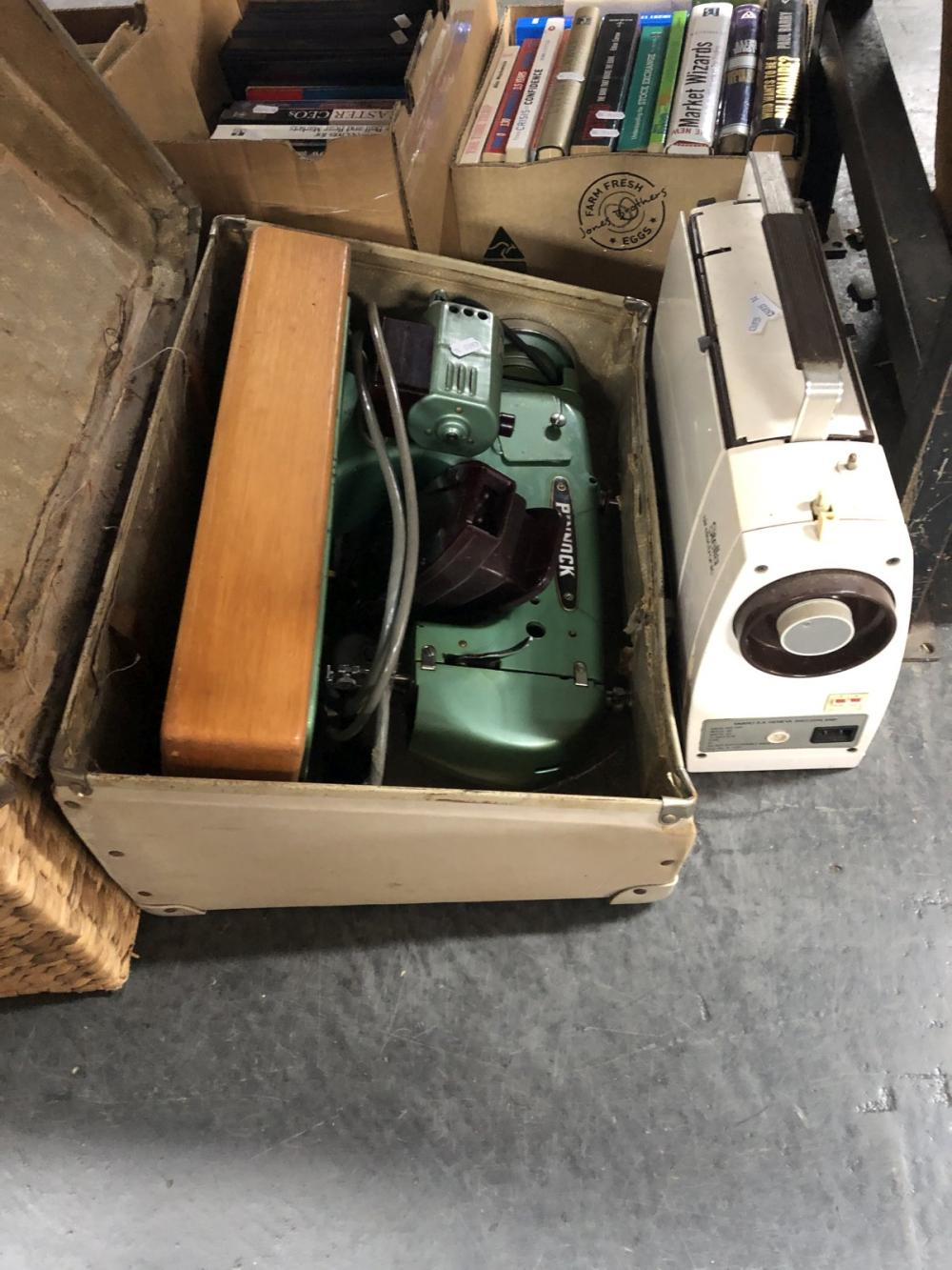 Pinnock Sewing Machine in Suitcase, an Elna Sewing Machine & a Crochet Thread & Doilies