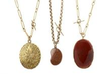 THREE ANTIQUE GOLD PENDANT NECKLACES; a 9ct cased front and back locket on 9ct chain, jasper pendant set in 9ct on 9ct chain and a s...