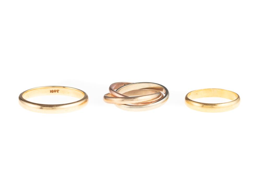 THREE GOLD WEDDING BANDS, 22ct size F1/2, 1.54g, 18ct size N, 2.74g, and a tri colour 9ct Russian wedder size F, 2.82g.