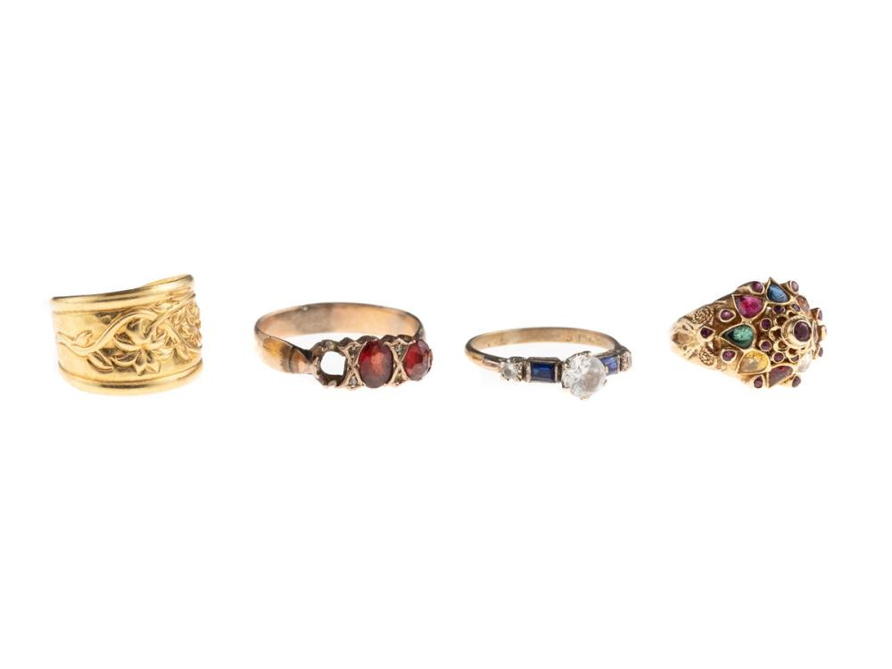 FOUR ASSORTED GOLD RINGS; a flexible 3/4 hoop in 18ct, 3.16g, 2 in 14ct set with rubies, sapphires, emeralds, citrine and garnets si...