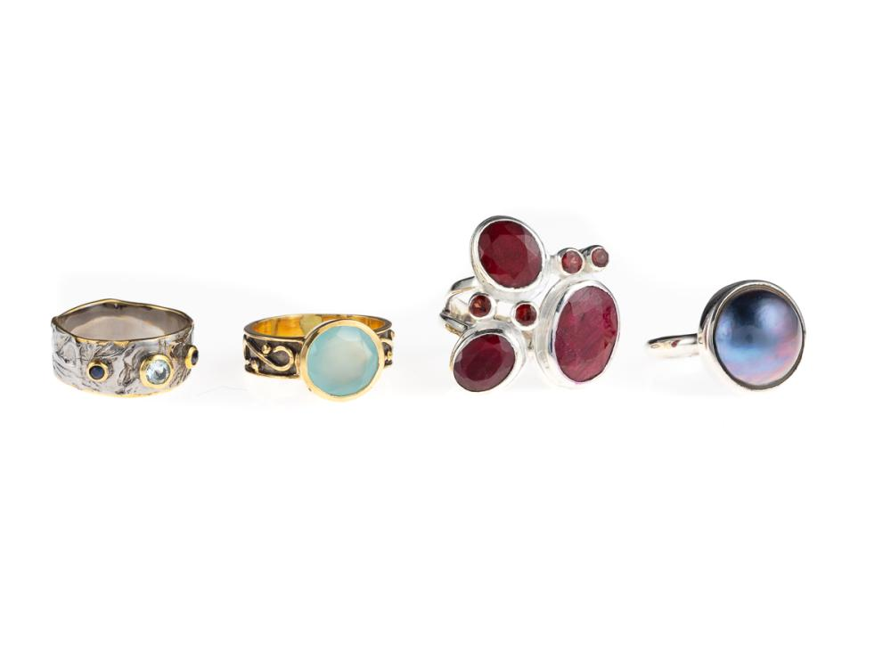 FOUR SILVER GEMSET RINGS; one rub set with 3 oval cut rubies and 4 round cut garnets (size P 1/2), a black mabe pearl (N), one with...