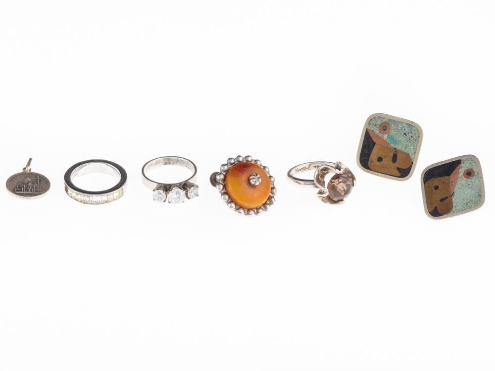 A GROUP OF SILVER JEWELLERY; 3 rings set with a smoky quartz (size K1/2) and zirconias (M & M1/2), 1 amber bead set screw earring, a...
