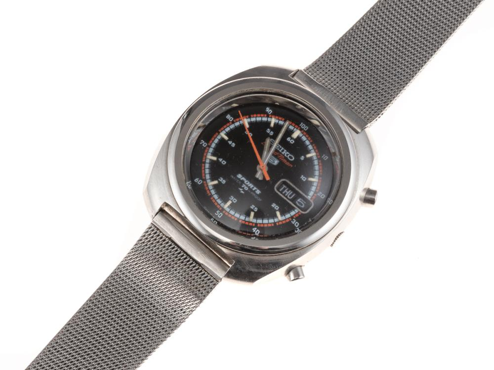 A VINTAGE SEIKO SPEED TIMER SPORTS AUTOMATIC CHRONOGRAPH WRISTWATCH; ref. 7017-8000 in stainless steel, black dial, day date, 21 jew...