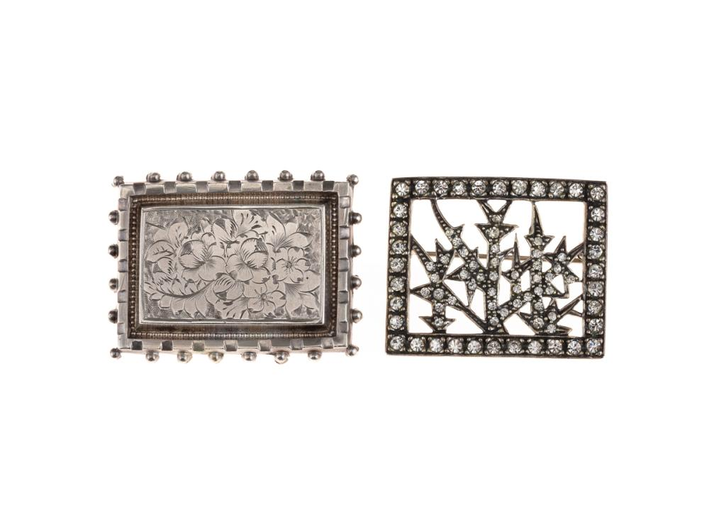 TWO VINTAGE SILVER BROOCHES; one with floral engraving and beaded border, 35 x 25mm, other set with white stones, 25 x 32mm.