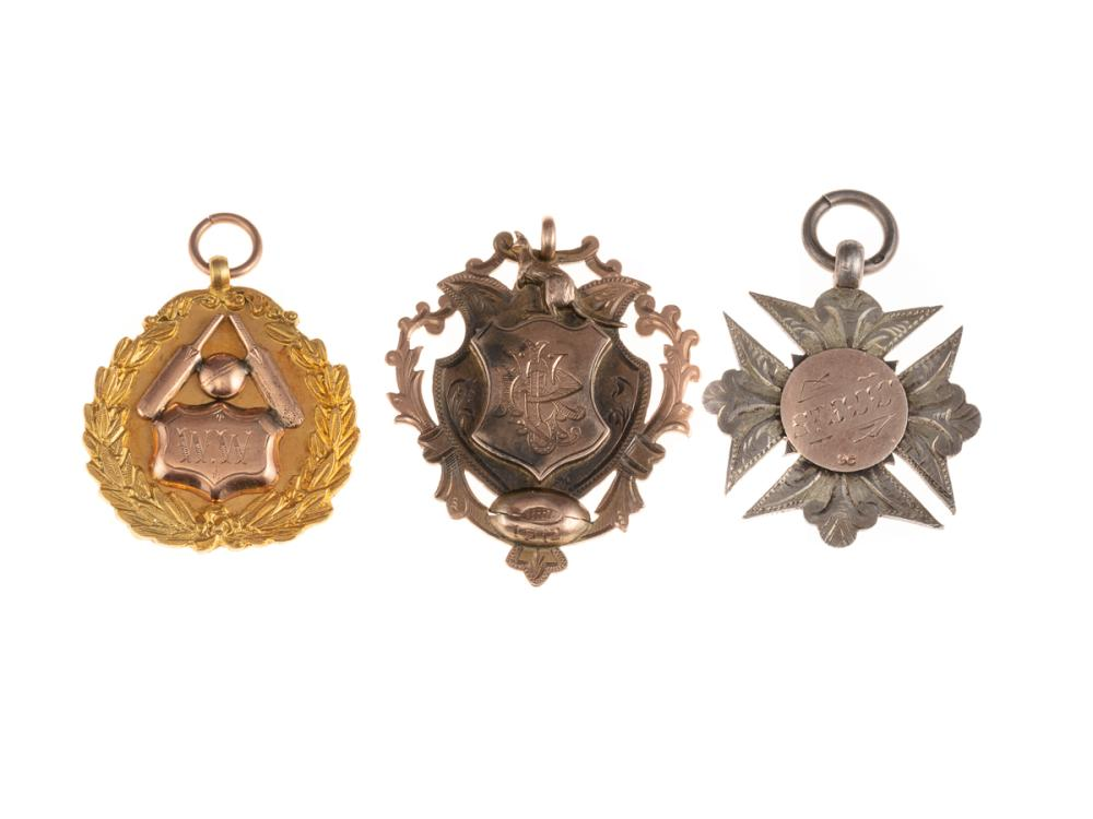TWO 9CT GOLD AND A SILVER PRESENTATION FOB; awarded to W Watson, Moore Park CA 1914-15 A Grade, Haron Medal, Eastern Suburbs Dist. 3...