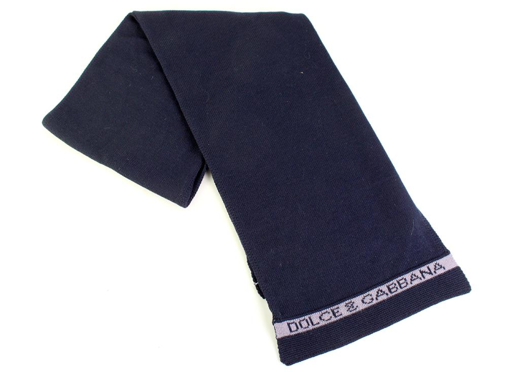 A DOLCE & GABBANA KNITWARE SCARF; navy blue and grey wool and acrylic, with tag and hologram sticker, 27 x 172cm.