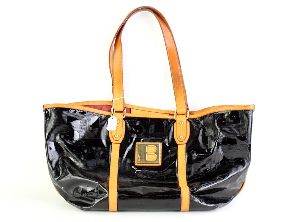A BALLY PATENT LEATHER B LOGO TOTE BAG; embossed black leather with tan leather trim and handles, gilt metal hardware and B to front...