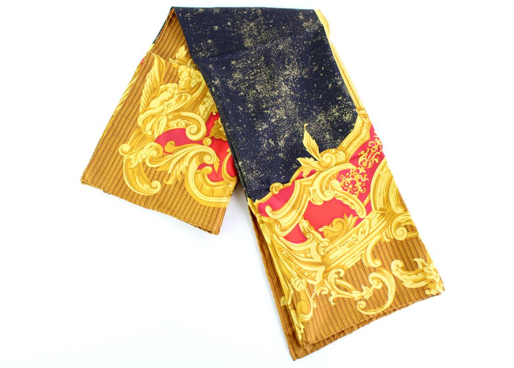 GIANFRANCO FERRE SILK SCARF; in red, black and gold with rolled edge and label, 86 x 86cm.