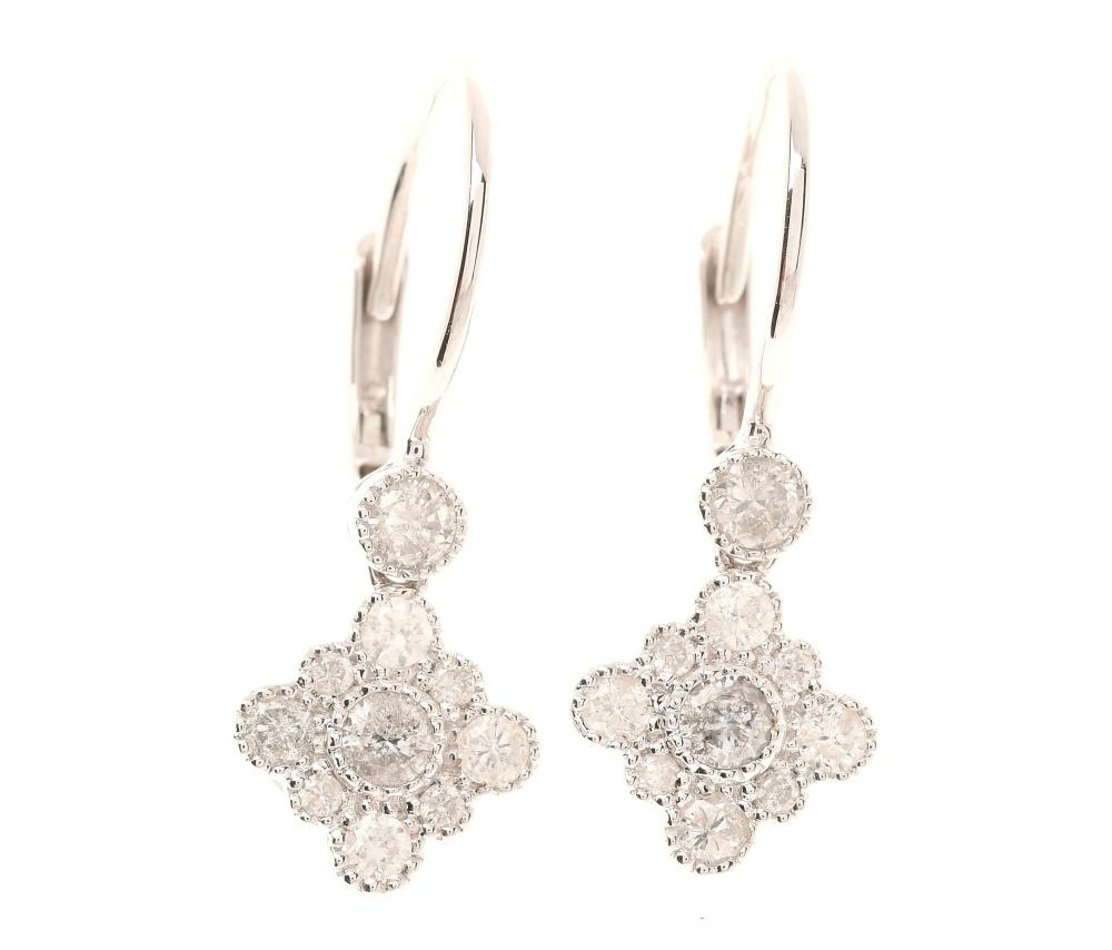 A PAIR OF 18CT WHITE GOLD DIAMOND EARRINGS; quatrefoil clusters of round brilliant cut diamonds to locking shepherds hook fittings s...