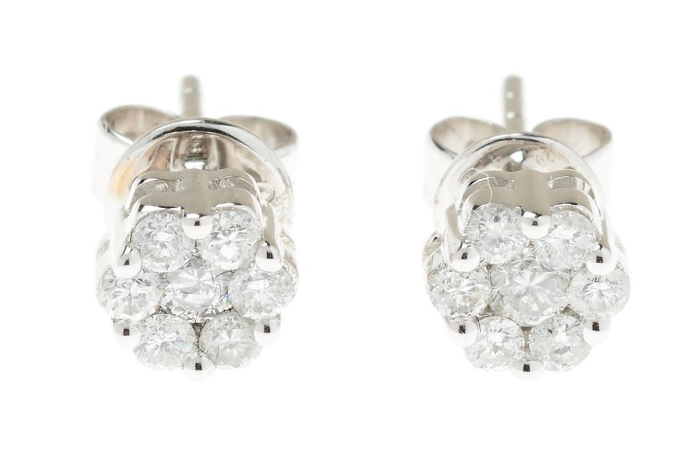A PAIR 18CT WHITE GOLD DIAMOND CLUSTER STUD EARRINGS; set with 14 round brilliant cut diamonds totalling 0.39ct.