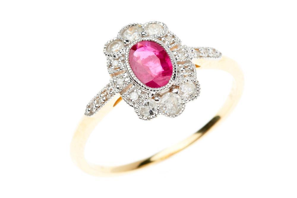 AN 18CT GOLD DECO STYLE RUBY AND DIAMOND RING; centring an oval cut ruby (treated) of 0.55ct to surround and shoulders set with 18 r...