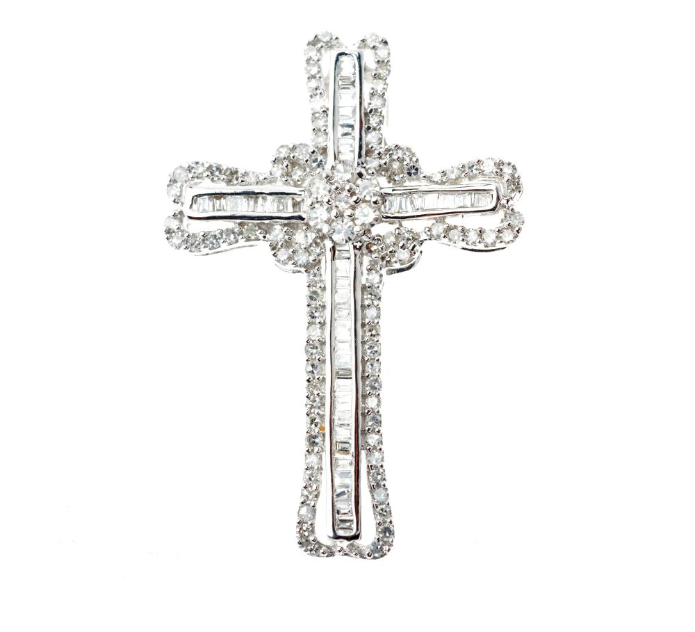 AN 18CT WHITE GOLD DIAMOND CRUCIFORM PENDANT; set with single and baguette cut diamonds totalling approx. 0.51ct, length 28mm.