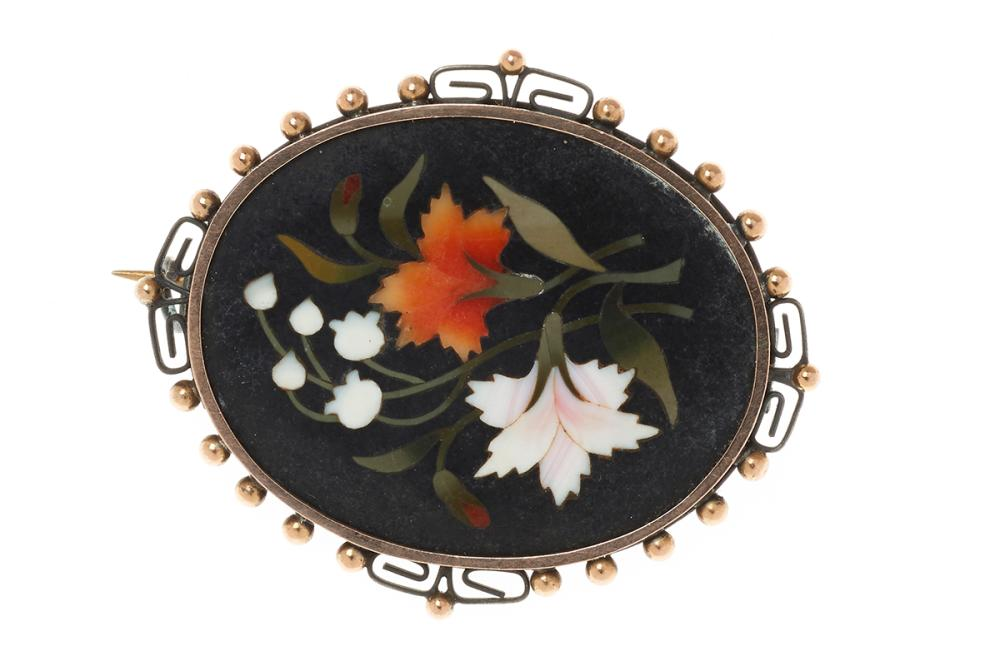 AN ANTIQUE PIETRA DURA BROOCH; featuring a 33 x 26mm finely inlaid panel set in a silver frame with gold beading.