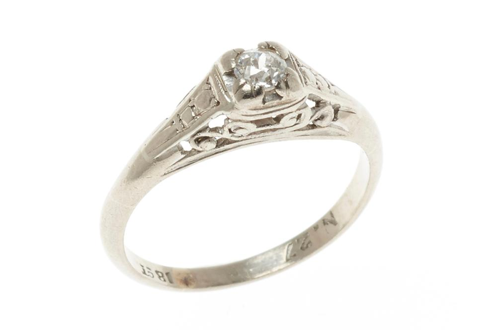 A VINTAGE 18CT WHITE GOLD SOLITIARE DIAMOND RING; featuring an Old European cut diamond of approx. 0.12ct in a pierced mount, size K...