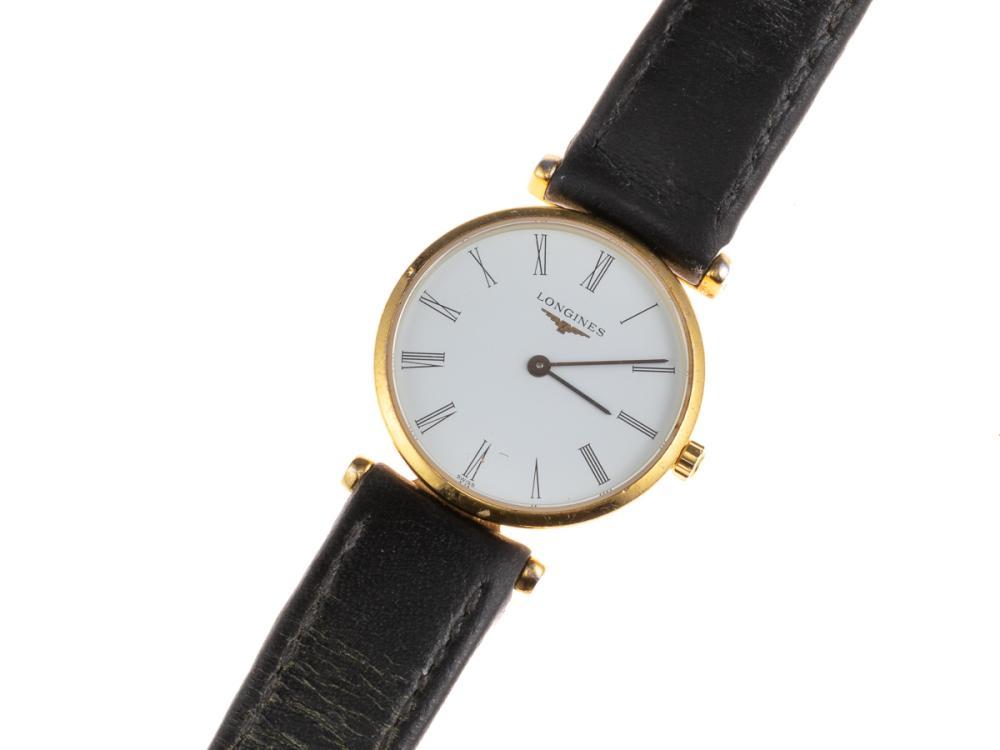 A LADY'S LONGINES LA GRANDE CLASSIQUE QUARTZ WRISTWATCH; ref; l4209.2 with white dial, Roman numerals, gold plated case, leather ban...