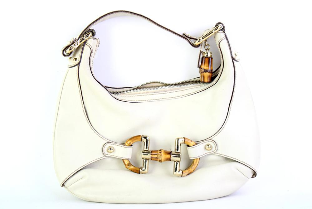 A GUCCI ALMAFI BAMBOO HORSEBIT HOBO BAG; in cream leather with gilt metal and bamboo hardware, internal tag no. 154378-002046, size...